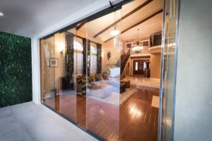 Partially open sliding glass doors separating living area from outdoor patio.