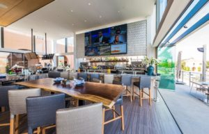 Restaurant bar with stacked frameless sliding glass doors.