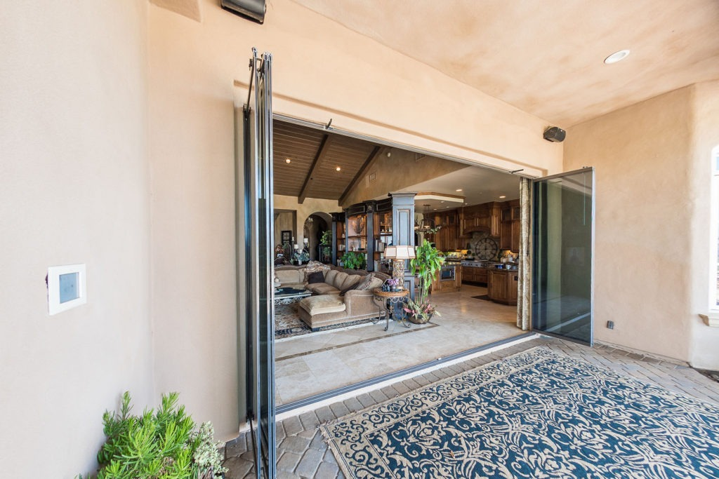 Opened frameless sliding glass doors.