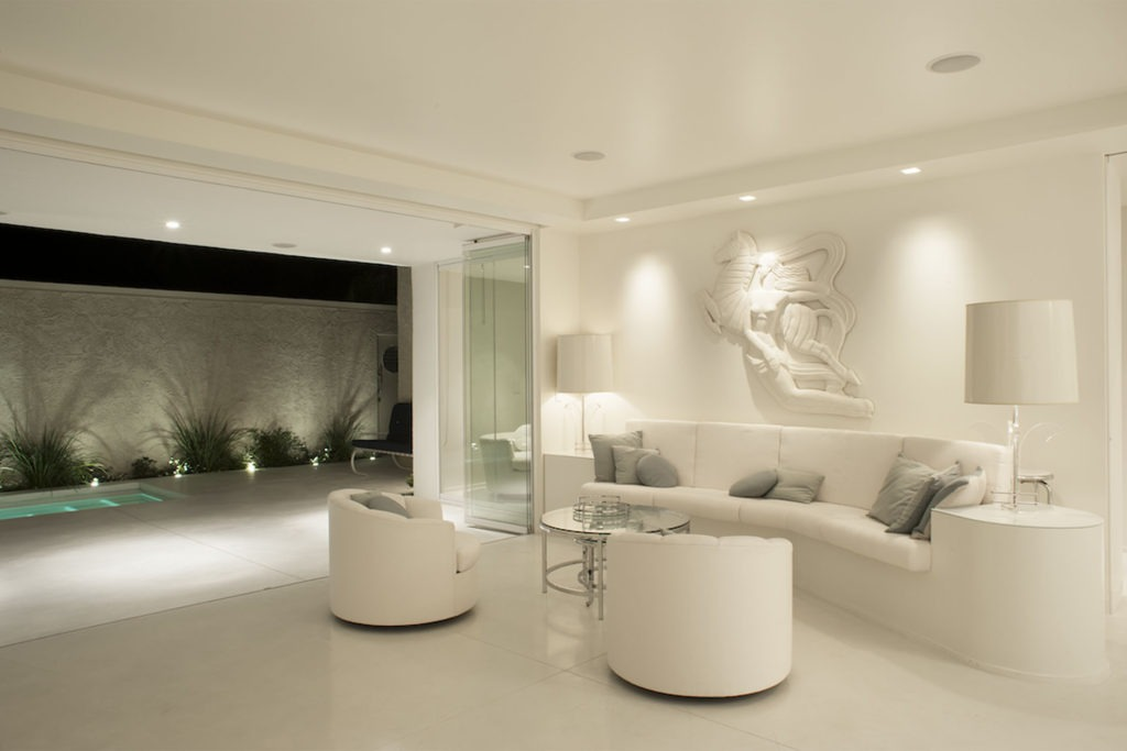 white living room frameless glass