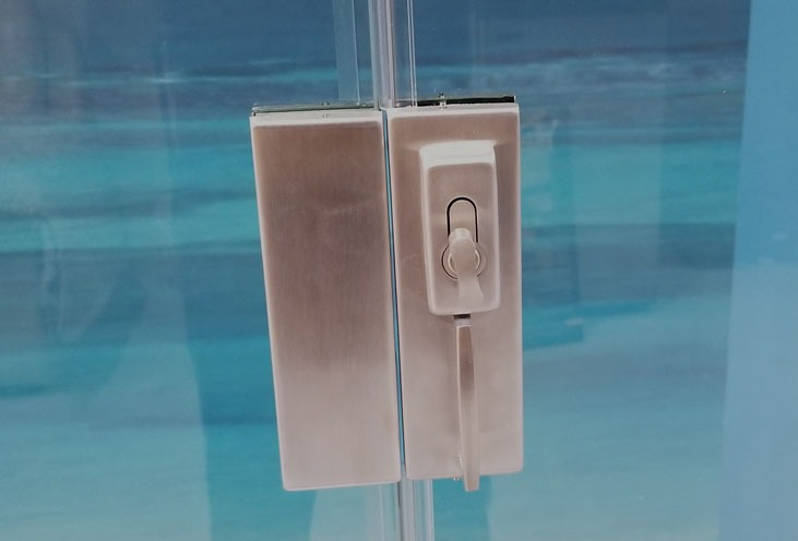 Photo of glass door locking hardware