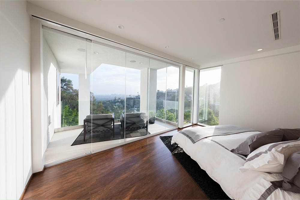 Looking outside bedroom frameless glass doors