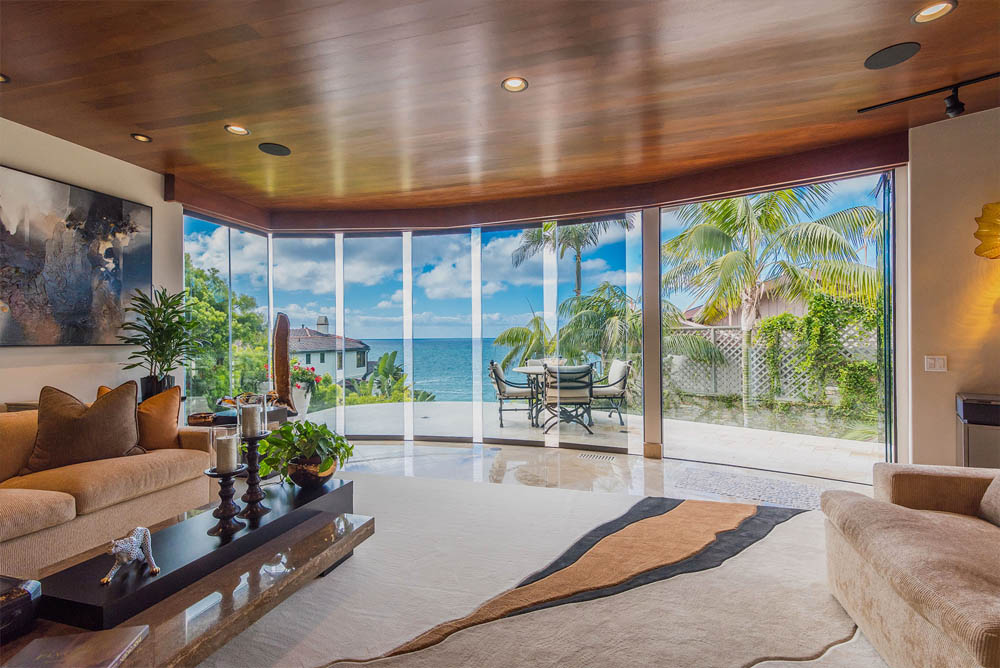 Beautiful view from inside home through frameless glass doors