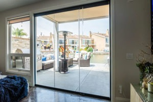 Looking at patio through enclosed frameless sliding glass doors.