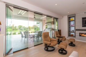 Partially open sliding glass doors connecting a living space with the outdoors.
