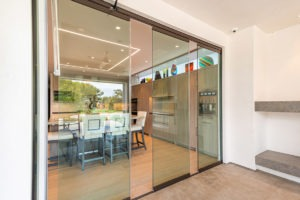 Partially open sliding glass doors showing kitchen area from patio.