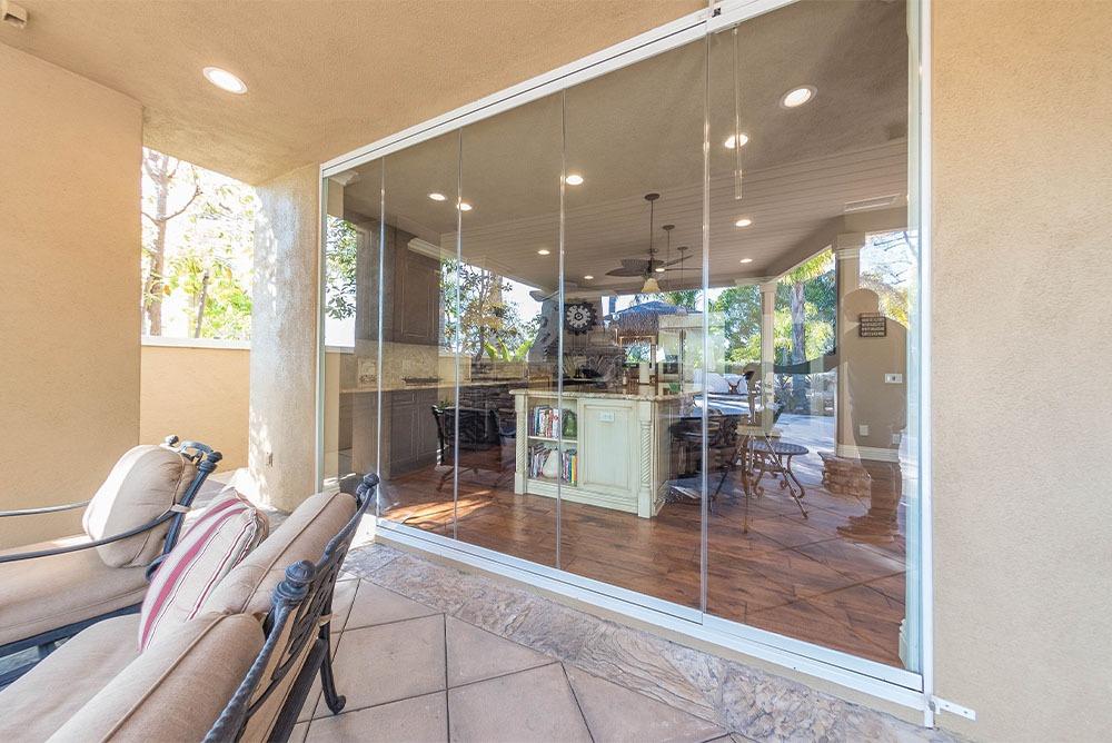 Looking outside living room frameless glass doors