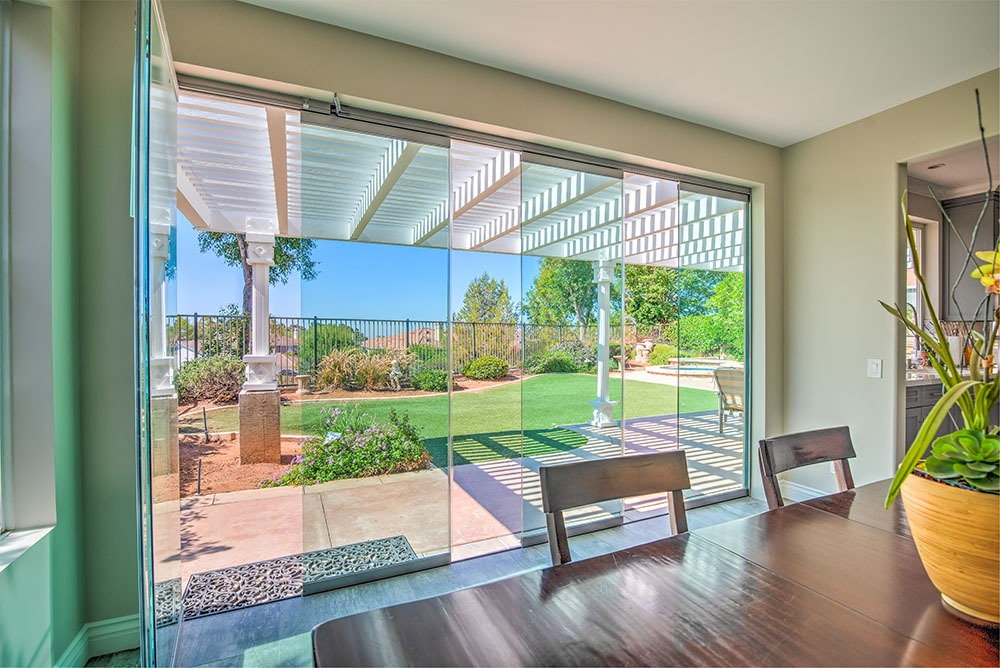 Patio with open frameless glass doors